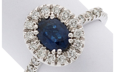 Sapphire, Diamond, White Gold Ring The ring features an...