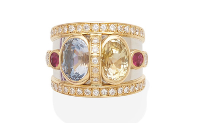 a gold, diamond, blue and yellow sapphire ring