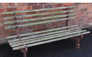 A 19th century cast iron and hardwood garden bench, the pair...
