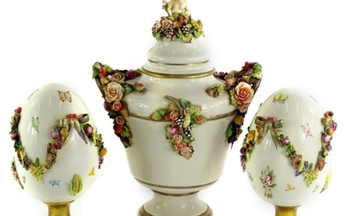 A Capodimonte porcelain garniture, the central two handled u...