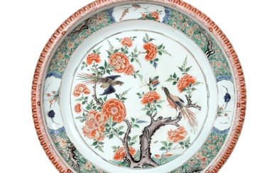 A Chinese Porcelain Charger, Kangxi, painted in famille verte enamels...