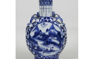 A Chinese blue and white porcelain moon flask with dragon ha...