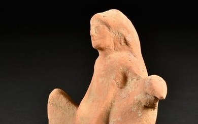 A Greek Dove with Seated Kore