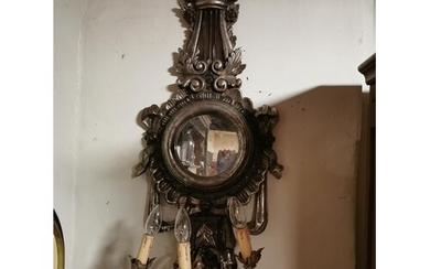 A PAIR OF CARVED GILT WOOD AND GESSO GIRONDEL MIRRORS Lyre f...