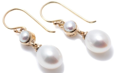 A PAIR OF FRESHWATER CULTURED PEARL DROP EARRINGS; 7 x 8.2mm oval pearls to 9ct gold collet set river pearls on shepherds hook fitti...