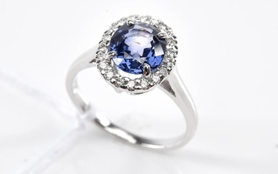 A SRI LANKAN INDIGO BLUE SAPPHIRE (WEIGHING 2.25CTS) CLUSTER RING, IN 18CT WHITE GOLD, SIZE N, WITH AIG REPORT STATING NO INDICATION...