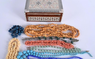 A VINTAGE BOX together with various necklaces. (qty)