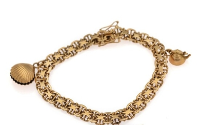 A bracelet of 18k gold set with two charms of 18k gold and two silver...