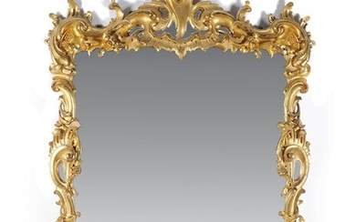 A carved giltwood overmantel mirror