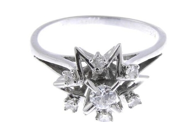 A diamond star cluster ring. Estimated total diamond...
