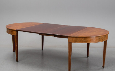 A english style dining table from the first half of the 20th century