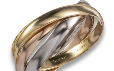 A gold trinity bangle by Cartier, the polished gold connecting bangles are in rose, yellow and white gold, signed and numbered C20509, 5.8cm inner diameter, 80g Accompanied by insurance valuation dated 28 January 1995 from Cartier, London