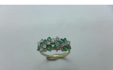 A hallmarked 9ct white gold diamond and emerald ring, size N...