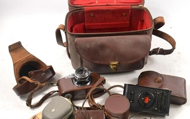 A large collection of high quality vintage cameras, lenses a...