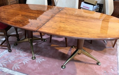 A large mid-20th century oval extending rosewood pedestal di...