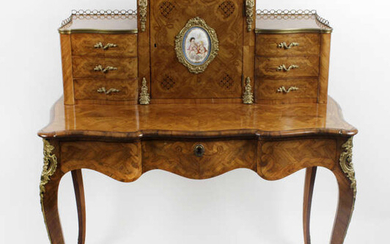 A late 19th century French satinwood and marquetry inlaid bonheur du jour.