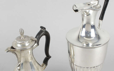 A late Victorian silver lidded jug or ewer & a small hot water pot. (2).
