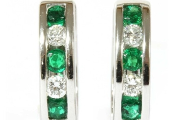 A pair of 18ct white gold emerald and diamond oval hoop earrings