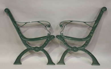 A pair of 20th century green painted cast iron garden bench ends of 'X' frame form, height