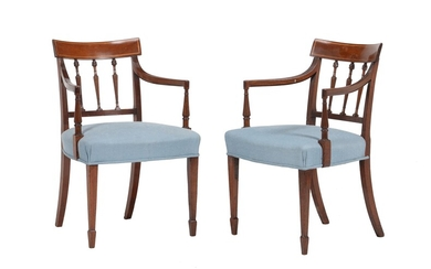 A pair of George III mahogany elbow chairs