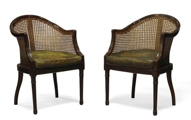 A pair of Regency style mahogany and caned bergere armchairs,...