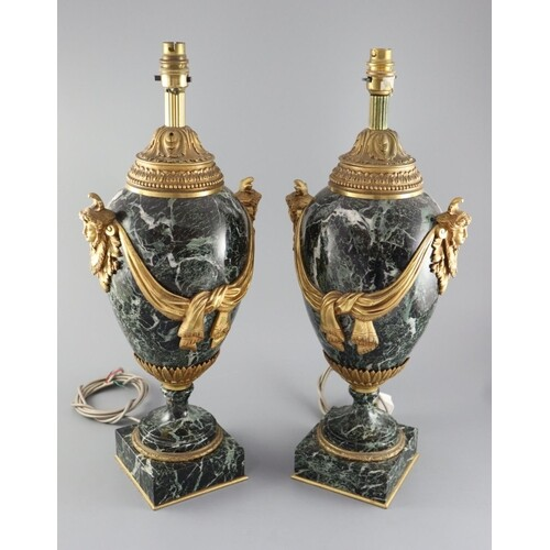 A pair of early 20th century ormolu green marble table lamps...