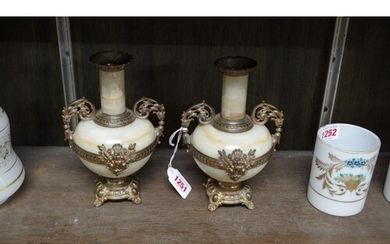 A pair of late 19th century onyx and cast brass twin handled...