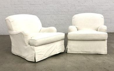 A pair of upholstered club armchairs