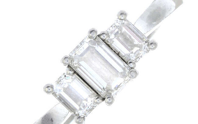 A platinum rectangular-shape diamond three-stone ring.