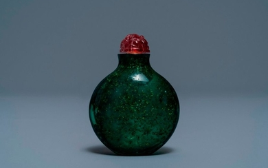 A rare Chinese biotite sandwiched green glass snuff...