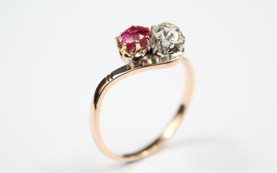 A rose gold diamond and ruby crossover ring, size...