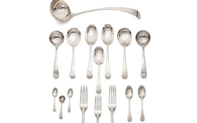 A silver Old English pattern table service for twelve by Josiah Williams & Co. of Bristol