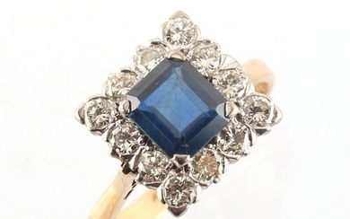 A yellow gold sapphire & diamond cluster ring, the octagonal...