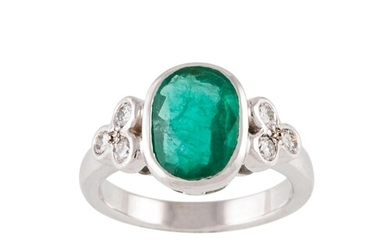AN EMERALD SINGLE STONE RING, the oval emerald collet set to...