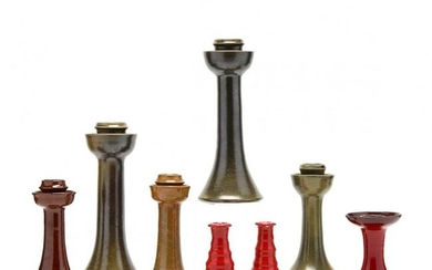 An Assorted Group of Eight NC Pottery Candlesticks