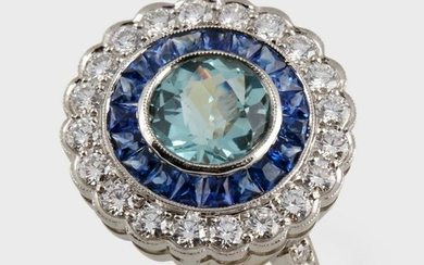 An aquamarine, sapphire, diamond, and platinum ring