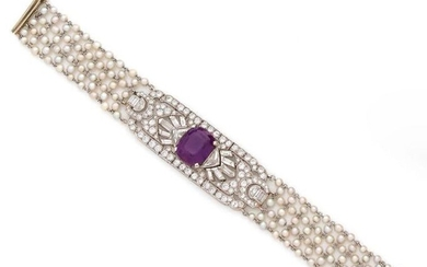 BRACELET RIBBON in platinum and 18K (750) white gold formed from a network of woven seed pearls, the central motif chiselled and pierced with interlocking geometric patterns, set with antique cut diamonds and centered with a cushion amethyst.