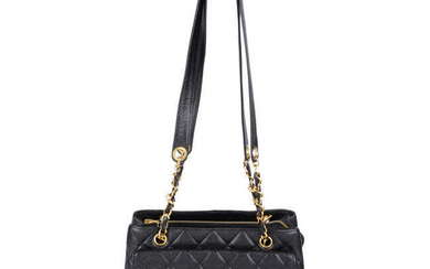 CHANEL - a quilted Caviar leather handbag.
