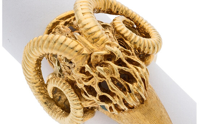 Emerald, Gold Ring The rams head ring features round-cut...