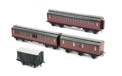 Four 1½ inch gauge passenger carriages and goods wagons