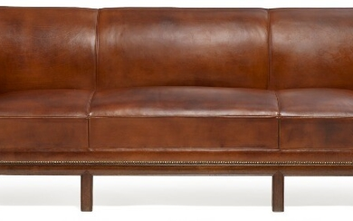Frits Henningsen: Freestanding three seater sofa with six-legged Cuban mahogany frame. Upholstered with patinated brown leather, fitted with brass nails.