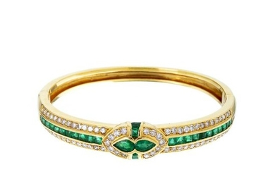 Gold slave bracelet with diamonds and emeralds