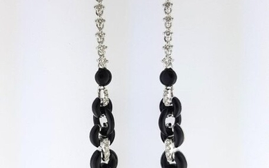 Pair of 750°/°°° white gold earrings set with diamonds alternating with onyx rings holding a freshwater cultured pearl in pendants, L 9cm, Gross weight: 8,87g