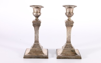 Pair of Victorian silver candlesticks in the classical style...