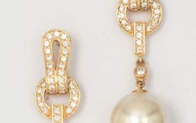 Pair of yellow gold earrings with a pair...