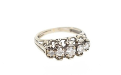 Ring in 18 K (750 °/°°°) white gold set with five brilliants falling on a line, with a central one of about 0.20 ct.