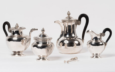 SERVICE In silver 5 thousandth. Composed of a coffee pot, a teapot, a milk jug and a sugar bowl. Of ovoid shape. Empire style. Master goldsmith : Delheid Frères. Numerous shocks. A silver metal sugar tongs from the Washer and Haillez families are...