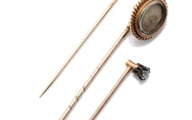 THREE ANTIQUE STICK PINS; one silver claw set with an approx. 0.20ct Old European cut diamond on 12ct gold back and 9ct pin, an Earl...