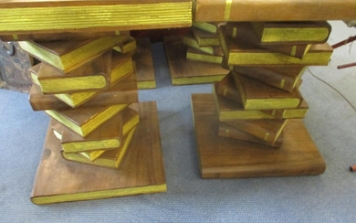 Two hardwood tables in the form of stacked books with gilt p...