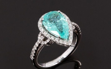 18k (750 thousandths) white gold ring set with a 4.31 ct. pear-shaped natural paraiba tourmaline in a setting of round brilliant diamonds. The shoulders of the ring are paved with diamonds. Beautiful mint blue green colour with a nice transparency...